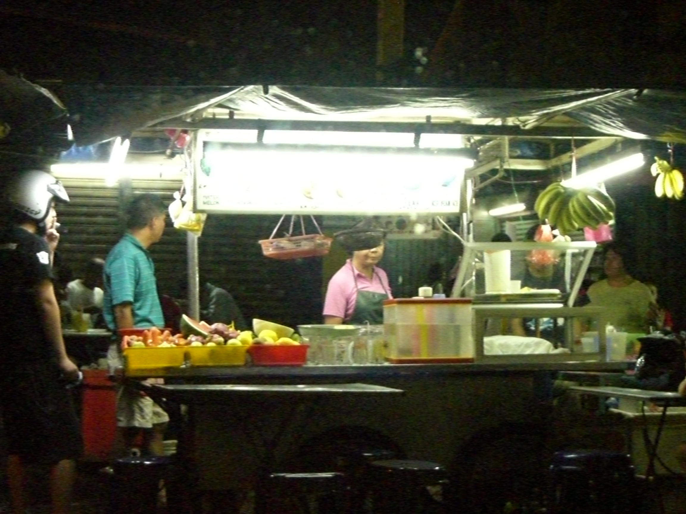 A quick photo of the fruit stall that is blur